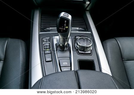 Automatic gear stick (transmission) of a modern car multimedia and navigation control buttons. Car interior details. Transmission shift.