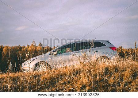 VILNIUS, LITHUANIA - SEPTEMBER 2017 - KIA car against autumn forest background