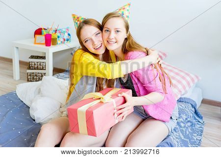 A portrait of two girls at a sleepover