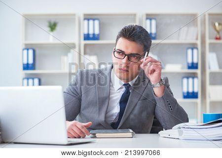 Businessman smoking in office at work