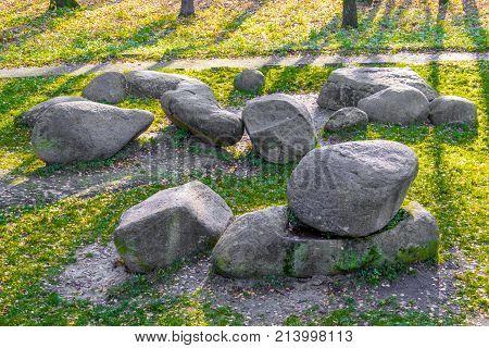 Stonehenge On Green Grass Underneath Blue Sky In Park