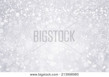 Silver white glitter sparkle confetti background for happy birthday party invite, Christmas fairy lights bokeh blur wallpaper, winter snow frost ice flyer, 25 anniversary or wedding glam spark shine
