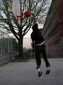dunking at a high school ** Note: Slight blurriness, best at smaller sizes poster