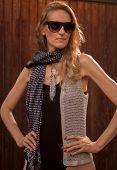 fashionable beautiful one mature Caucasian woman posing late 40s ex fashion model posing upper body outdoors sunglasses poster