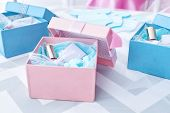 Boxes with baby shower favors on table poster