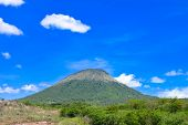 Landscape with one of the volcanic peaks in San Jacinto Leon Department Nicaragua. Blue sky background poster