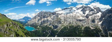 Alpine Dolomites Landscape, Italy. Glacier Marmolada And Lago Di Fedaia In Summer.