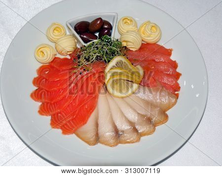 Slices Of Red Fish And Herring With Lemon And Olives And Butter Balls. Sumptuous Restaurant Dish