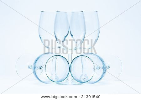 Empty wine glasses stand and lie symmetrically