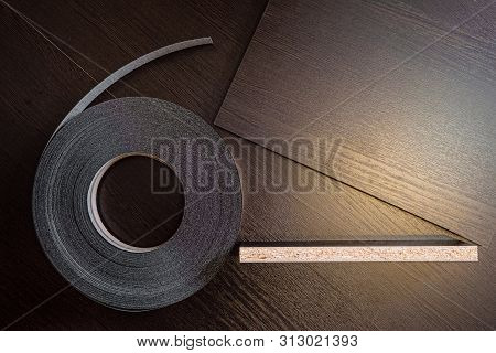 Roll melamine edge for finishing of furniture. Edging tape and laminated chipboard sheets wenge color. poster