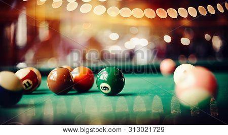 Colorful Billiard Balls On A Green Billiard Table. Gambling Game Of Billiards. Billiard Ball With Nu