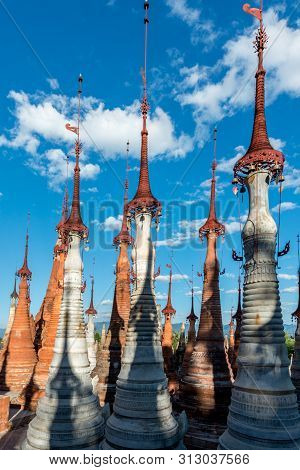 Vertical Picture Of Beautiful Old Stupas At Indein Temple Located In Inle Lake During Blue Sky Day,