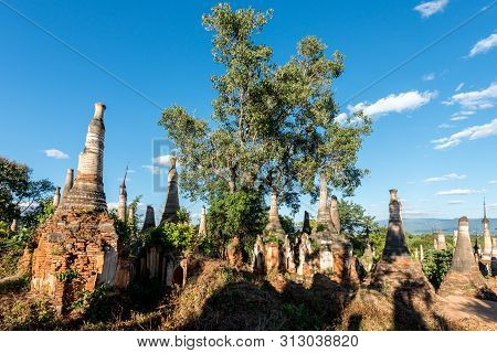 Wide Angle Picture Of Ancient Stupas With Local Vegetation At Indein Temple Located In Inle Lake Dur