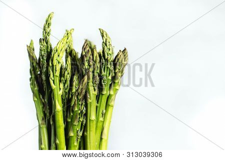 Fresh Bunch Of Asparagus With Smooth Daylight On Grey Stone Background Top View And Free Space For T