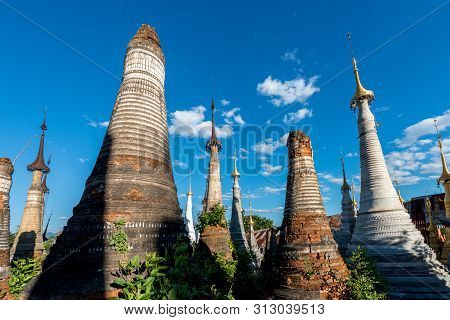 Horizontal Picture Of Local Vegetation With Different  Architecture Stupas At Indein Temple, Landmar