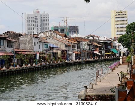 Malacca, Malaysia--february 2018: Old Traditional Buildings Along The Riverbank Of Melaka River In M