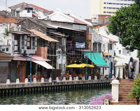 Malacca, Malaysia--february 2018: Close Up Of Old Buildings Along The Riverbank Of Melaka River In M