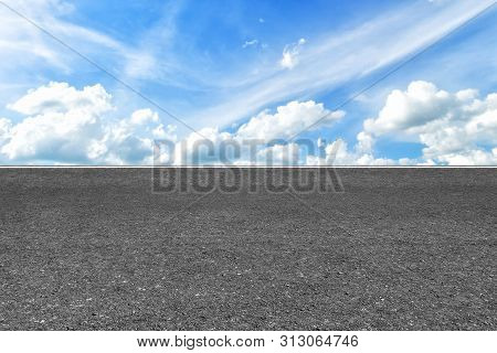 Asphalt Road With Marking Lines White Stripes Texture And Blue Sky Background Texture With White Clo