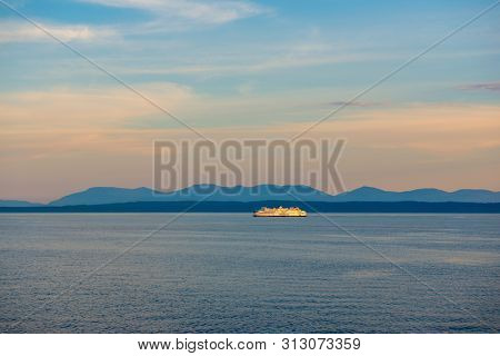 NANAIMO, BC - JUNE 19, 2018: A BC ferry sailing at sunset in Nanaimo. BC ferries provides all major ferry services for coastal and island communities in BC.