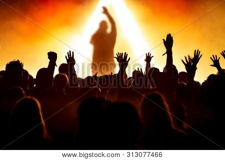 silhouettes of audience at rock concert