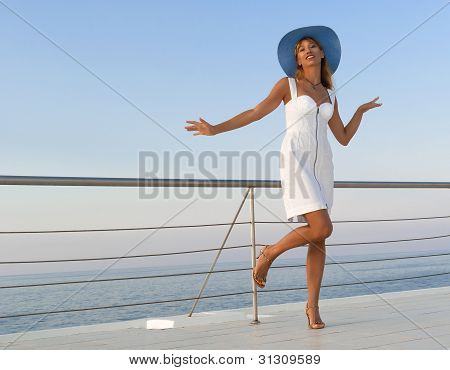 Elegant Sexy Woman In White Dress Dancing Near Railings At Sunset
