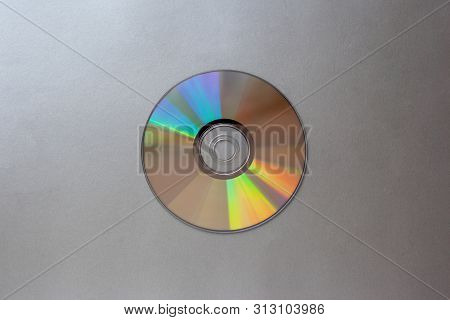 Cd Compact Disc On A Silver Background Top View With Copy Space Close-up