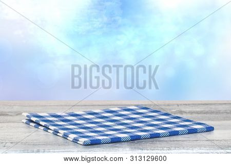 Empty Table Top Summer Background. Closeup Of A Empty Blue Checkered Tablecloth Or Napkin On A Rusti