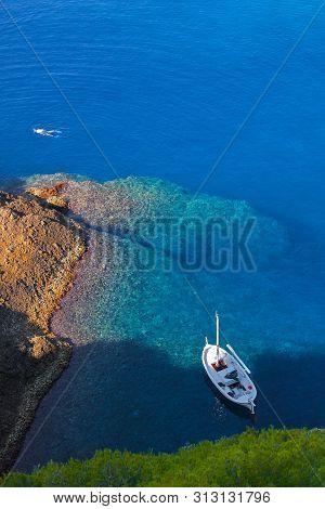 La Ciotat, Diver And Sailboat At Anchor Around The Green Island