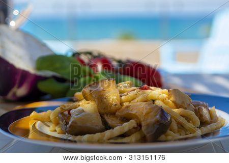 Sicilian Pasta Dish With Traditional Busiata Pasta And Sicilian Vegetables, Viola Eggplant, Tomatoes