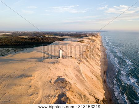 Lokken, Denmark - July 15, 2019: Aerial Drone View Of Rubjerg Knude Lighthouse And Sand Dunes.