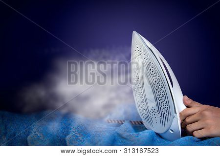 Hot Vertical New Iron Throws Cloud, Steam Iron. Electric Iron