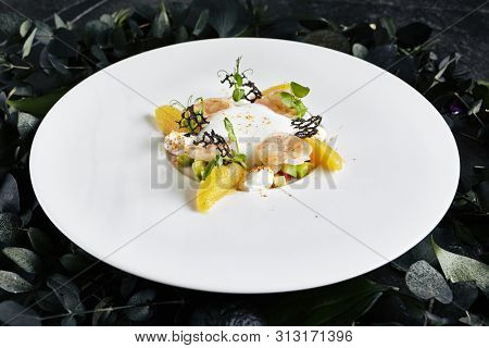 Exquisite Serving Restaurant Plate of Tiger Shrimps with Avocado Tartare and Sweet Chili under the Foam of Lime Juice. Macro Photo of King Prawns on Dark Leaves and Flowers Background poster