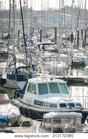 Busy Boating Marina With Lots Of Yachts And Small Pleasure Craft - No Product Identification Or Name