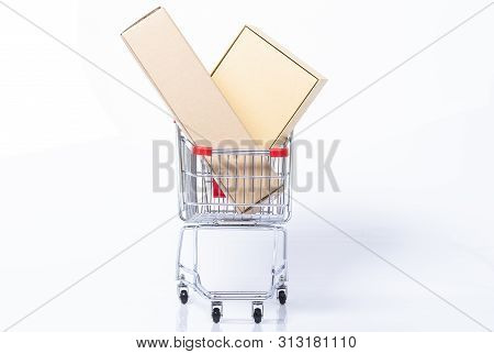 Front View Of A Shopping Trolley With Parcels, Isolated On White Background