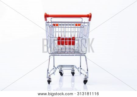 Rear View Of An Empty Shopping Trolley, Isolated On White Background