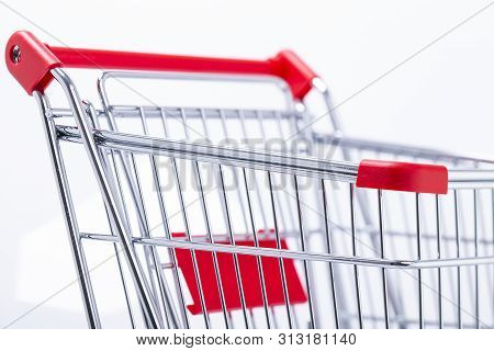 Image Shows An Empty Shopping Cart Sideways, Isolated On White