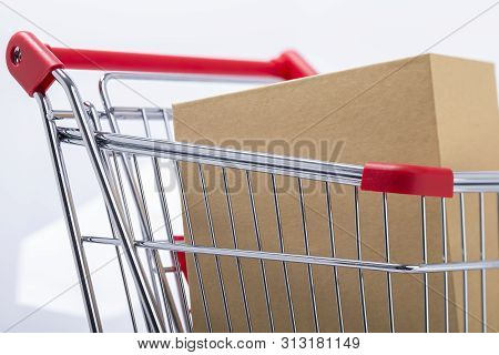 Image Shows A Shopping Cart Sideways With Parcel, Isolated On White