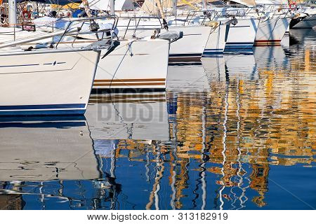 Reflection Of Yachts And Maltese Architecture In Water Of Malta Bay