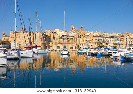 The View Of Historical Buildings Of Old Capital Vittoriosa Over The Dockyard Creek. Malta.