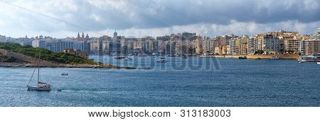 A Panoramic View Of Sliema Town And The Fort Manoel Coastline Across The Marsamxett Harbor From Vall