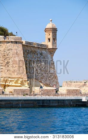 The View From The Water Of The End Of Senglea (l-isla) Peninsula  With The Guard Tower On The Tip Of