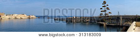 A Panoramic View Of The Entrance To The Grand Harbour (port Of Valletta) And Fort Ricasoli On Malta.