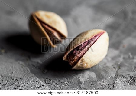 Big Set Of Salted Pistachios On The Table. Pistachios Nuts A