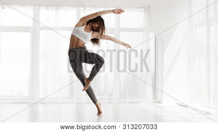 Pretty Girl Dancing Contemp And Ballet In Modern Dance Studio. Panorama, Empty Space For Text