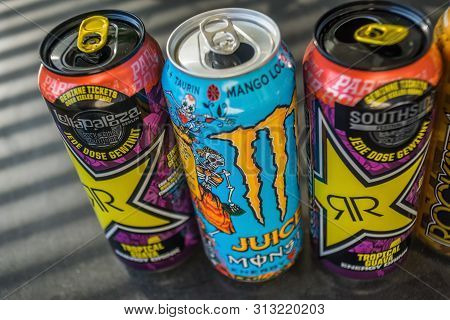 Boeblingen,germany - July 24,2019:stettiner Strasse Three Colorful Cans Of Energy Drinks Were Standi