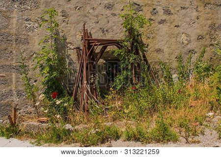 Disused Rusty Scaffolding Being Overgrown By Plants In The Small Historic Hill Village Of Clabuzzaro