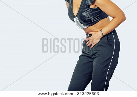Woman is experiencing pain, discomfort in lower abdomen, uterus, urethra. Presses hands to stomach. Isolated on white background. poster