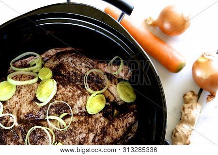 Marinated  Peking duck in a slow cooker with vegetables. poster