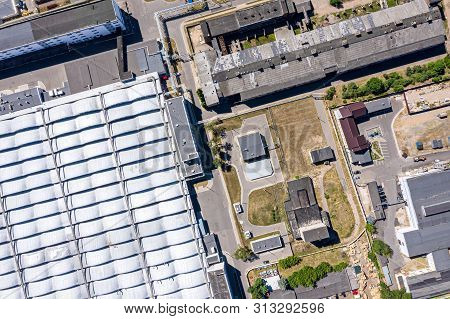 Top View Of City Industrial Zone. Roof Top Of Modern Factory From Above
