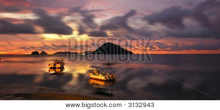 Sunset And Boats Over The South China Sea, Borneo